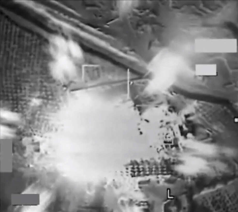 This image made from video released by U.S. Central Command, shows the aftermath of an airstrike on the Mayadin modular oil refinery in Syria, Wednesday, Sept. 24, 2014. Coalition warplanes bombed oil installations and other facilities in territory controlled by Islamic State militants in eastern Syria on Friday, Sept. 26, 2014, taking aim for a second consecutive day at a key source of financing that has swelled the extremist group's coffers, activists said. (AP Photo/U.S. Central Command)