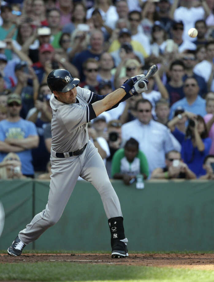 New York Yankees designated hitter Derek Jeter gets a hit against the Boston Red Sox, driving in Ichiro Suzuki, during the third inning of a baseball game Sunday, Sept. 28, 2014, at Fenway Park in Boston. This was the last at-bat in Jeter's baseball career. (AP Photo/Steven Senne)