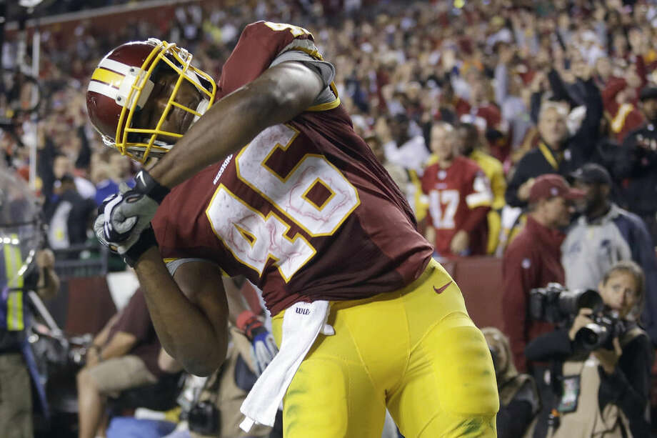 Washington Redskins running back Alfred Morris celebrates his touchdown during the second half of an NFL football game against the New York Giants in Landover, Md., Thursday, Sept. 25, 2014. (AP Photo/Patrick Semansky)