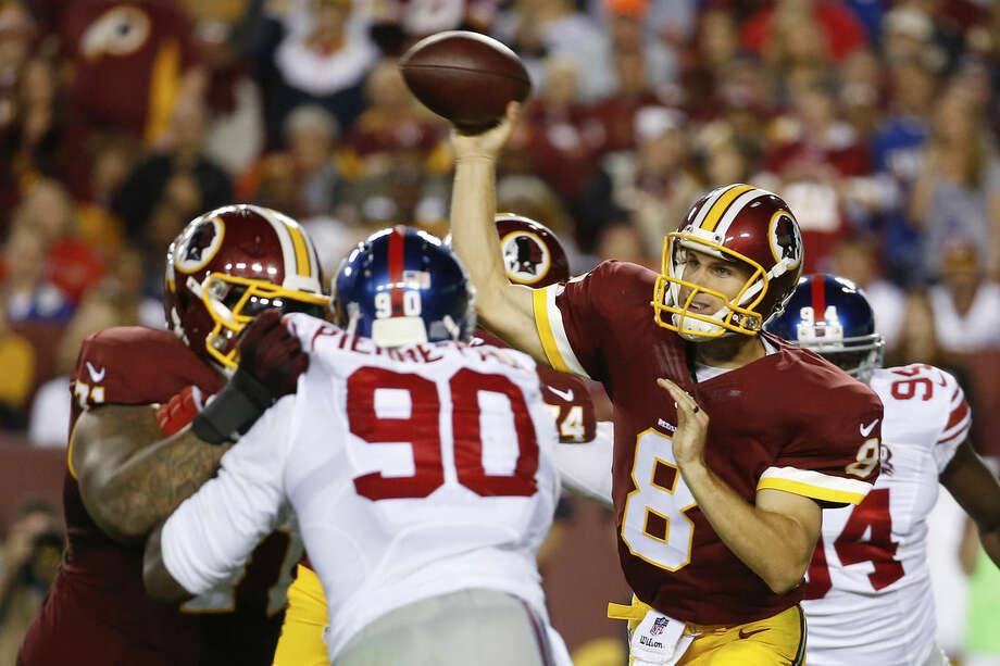 Washington Redskins quarterback Kirk Cousins (8) throws a pass during the first half of an NFL football game against the New York Giants in Landover, Md., Thursday, Sept. 25, 2014. (AP Photo/Alex Brandon)