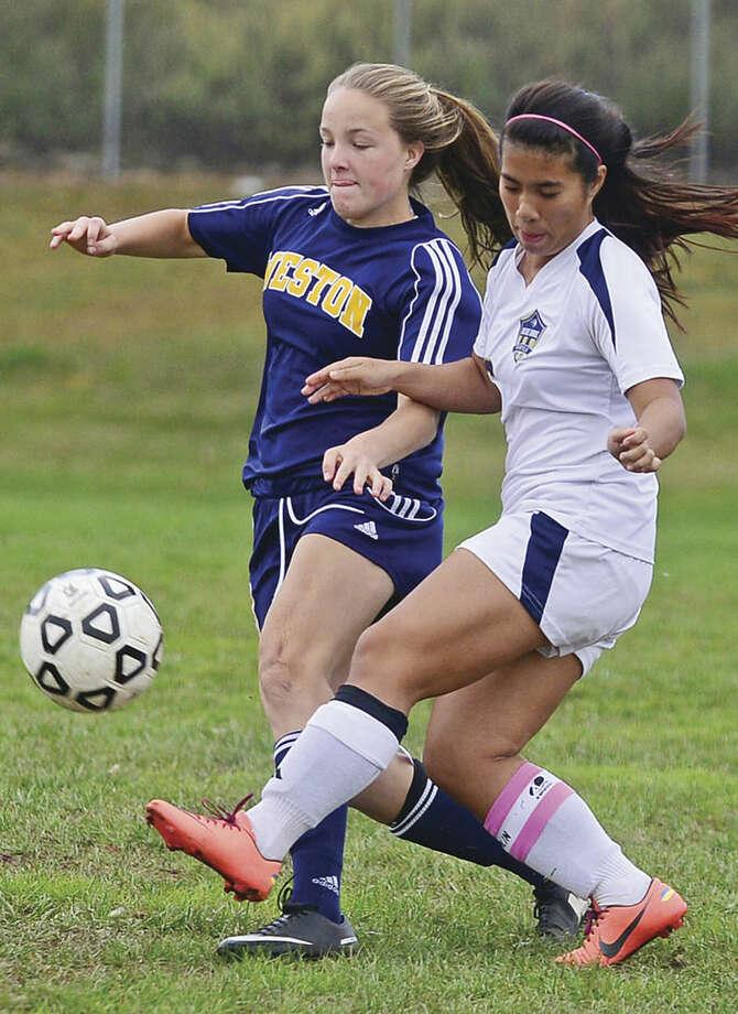Hour photo/Erik TrautmannAlexandra Alwang of Weston battles of Emily Wonsiewicz of Notre Dame in the girls soccer game in Fairfield Thursday.