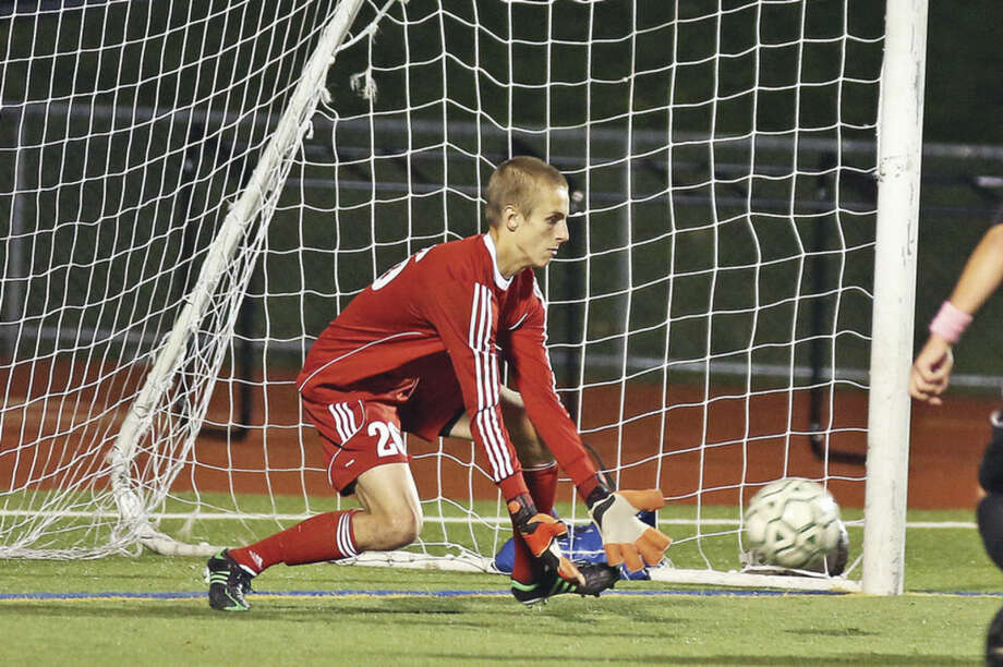 Hour photo/Danielle CallowayNorwalk goalkeeper Tyler Dalton makes a save during a game against Trumbull at Testa Field Thursday evening.