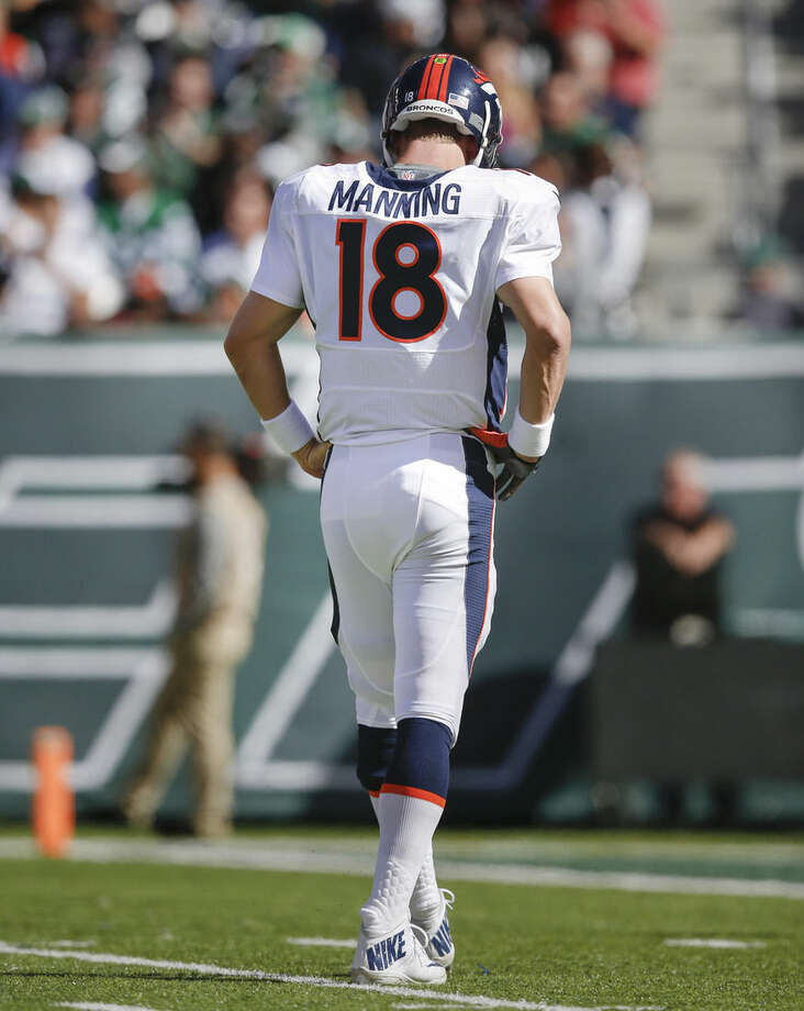 Denver Broncos quarterback Peyton Manning (18) walks off the field after turning the ball over to the New York Jets on downs during the second quarter of an NFL football game, Sunday, Oct. 12, 2014, in East Rutherford, N.J. (AP Photo/Kathy Willens)