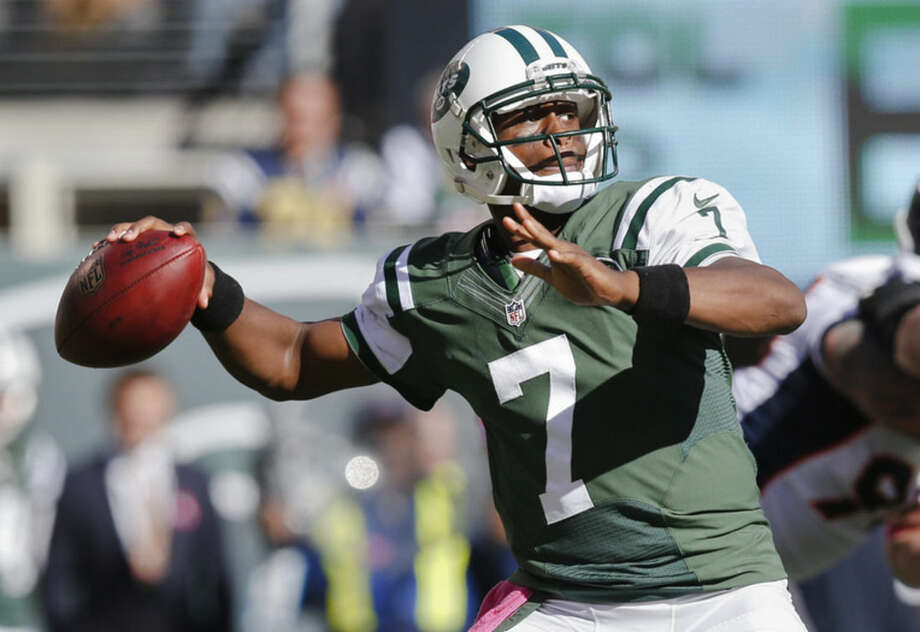 New York Jets quarterback Geno Smith (7) throws against the Denver Broncos during the third quarter of an NFL football game, Sunday, Oct. 12, 2014, in East Rutherford, N.J. (AP Photo/Kathy Willens)