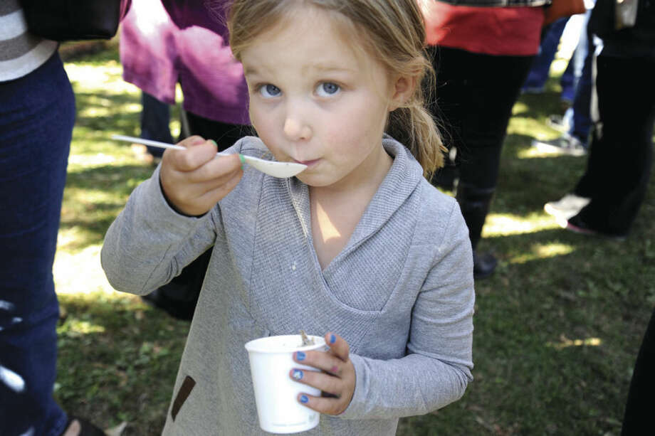 Hour photo/Matthew VinciSasha Wilker 4, samples some of the chowder Sunday at the Chowdafest held at Norwalk's Calf Pasture Beach.