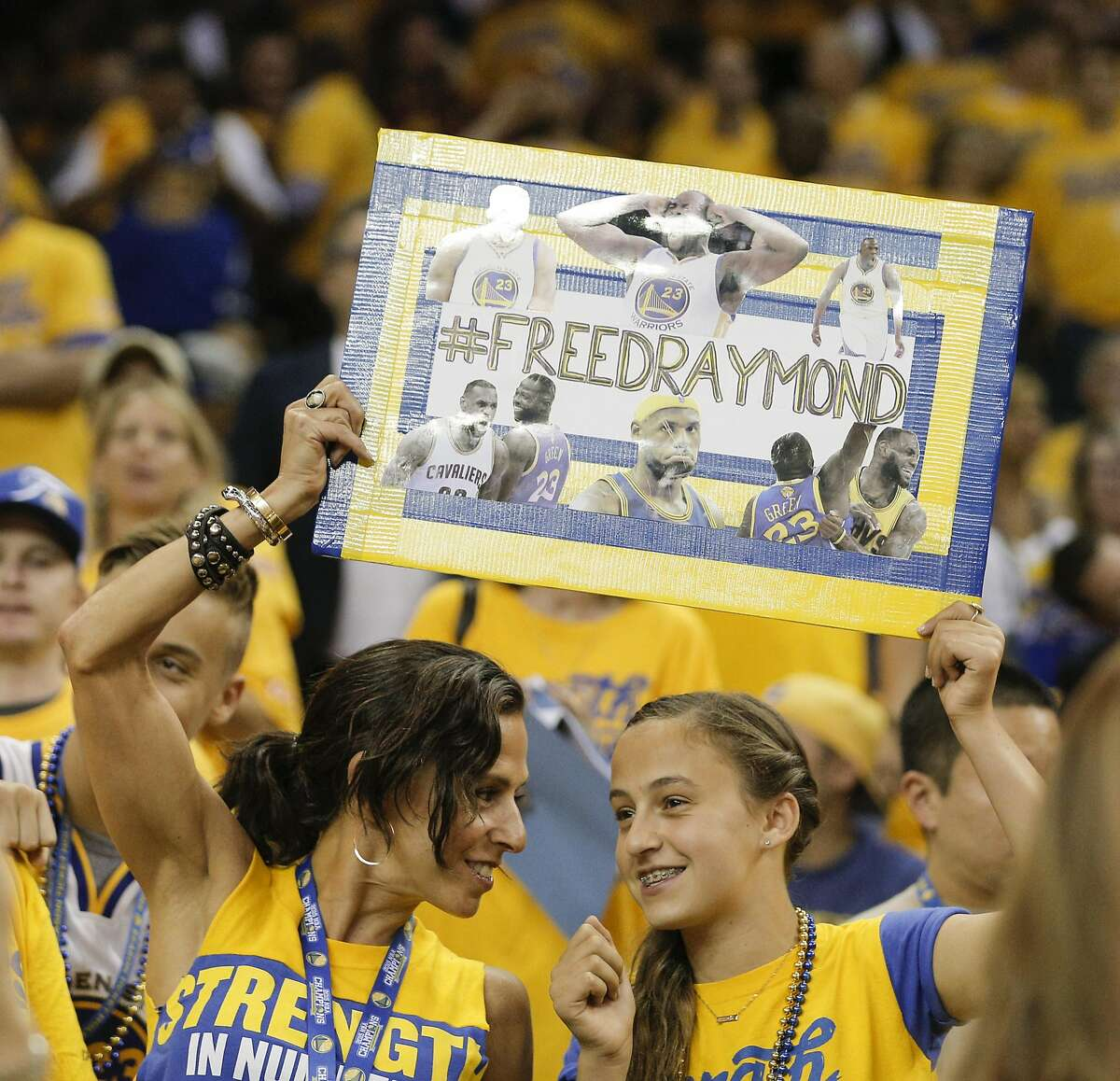 Warriors' fans hold up a #FreeDraymond sign during Game 5 of the NBA Finals at Oracle Arena on Monday, June 13, 2016 in Oakland, Calif.