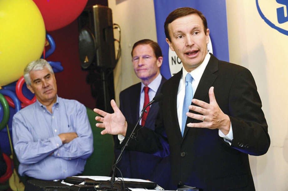 Hour photo / Erik Trautmann US Senator Chris Murphy thanks Google following the announcement naming Norwalk as the 2014 eCity capital of Connecticut Wednesday at Chalktalk Sports on Woodward Ave. The senator was joined by US Senator Richard Blumenthal and Chalktalk Sports co-owner J. Thomas Lynn. The eCity Awards recognize the strongest online business community in each state - the digital capitals of America. Google's award recognizes the city's innovative businesses by holding the community celebration with state and local elected officials, representatives of the Norwalk Chamber of Commerce and representatives from local small businesses.