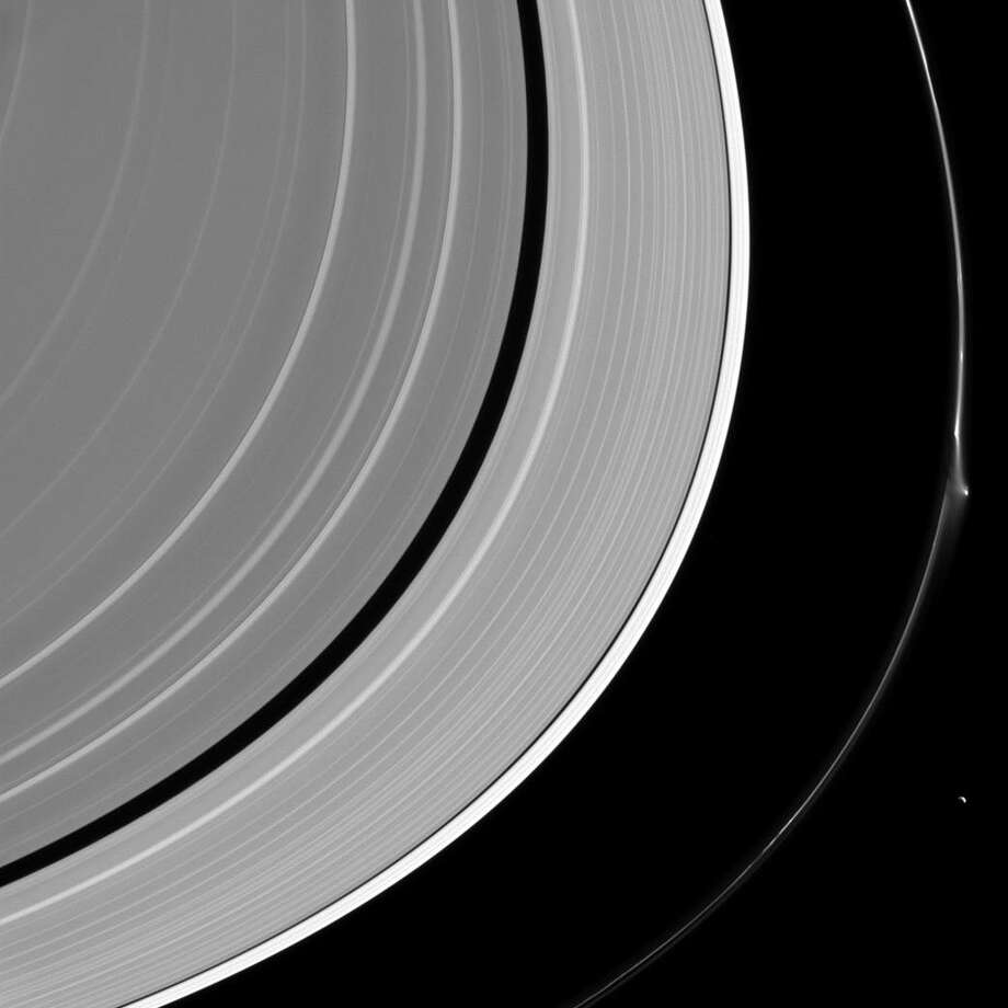 NASA caption: A bright disruption in Saturn's narrow F ring suggests it may have been disturbed recently. Pandora (50 miles or 81 kilometers across) lurks nearby, at lower right. Photo: NASA/JPL-Caltech/Space Science Institute