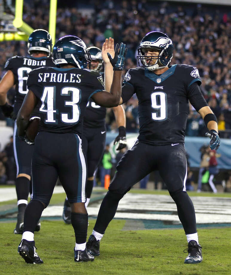 Philadelphia Eagles running back Darren Sproles (43) and quarterback Nick Foles (9) celebrate a touchdown by Sproles against the New York Giants during the second half of an NFL football game, Sunday, Oct. 12, 2014, in Philadelphia. (AP Photo/Matt Rourke)