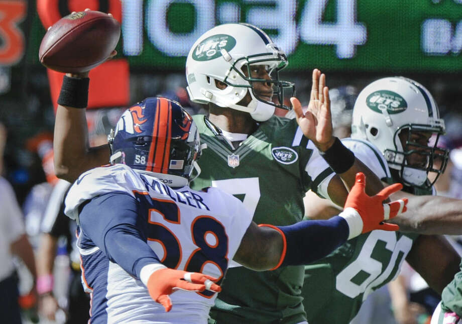 New York Jets quarterback Geno Smith (7) throws under pressure from Denver Broncos outside linebacker Von Miller (58) in the first quarter of an NFL football game, Sunday, Oct. 12, 2014, in East Rutherford, N.J. (AP Photo/Bill Kostroun)