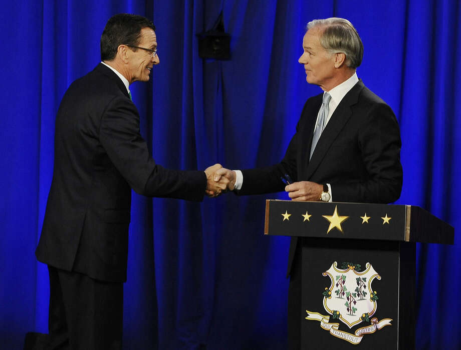 Incumbent Democrat Gov. Dannel P. Malloy, left, and Republican candidate for governor Tom Foley greet at the end of a debate, Thursday, Oct. 9, 2014, in Hartford, Conn. (AP Photo/Jessica Hill)