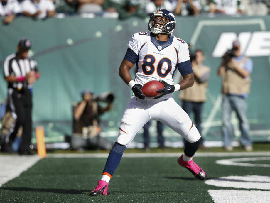 Denver Broncos tight end Julius Thomas (80) comes down with a touchdown pass against the New York Jets during the third quarter of an NFL football game, Sunday, Oct. 12, 2014, in East Rutherford, N.J. (AP Photo/Kathy Willens)