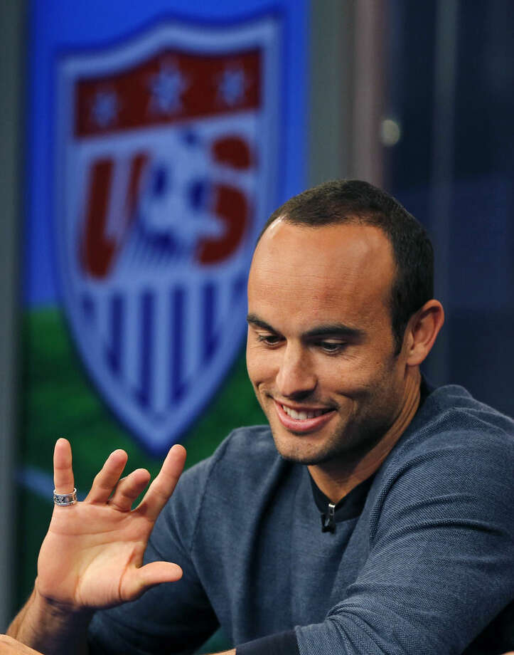 United States' Landon Donovan gestures as he speaks about his retirement from soccer during a press conference in Bristol, Conn. Friday, Oct. 10, 2014. Donovan makes his last international appearance Friday night in an soccer exhibition against Ecuador. (AP Photo/Elise Amendola)