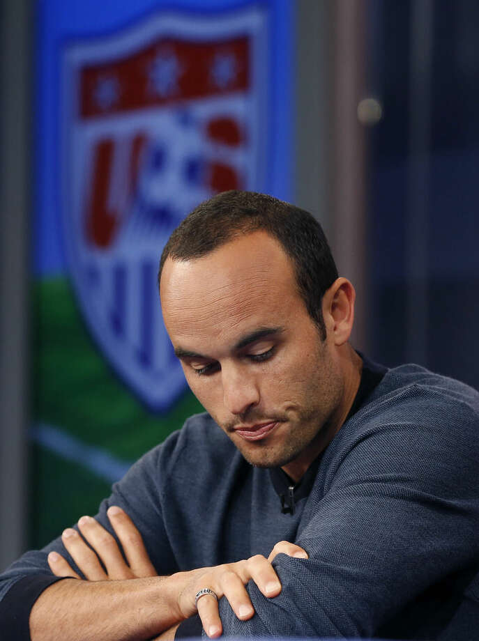 United States' Landon Donovan reacts as he speaks about his retirement from soccer during a press conference in Bristol, Conn. Friday, Oct. 10, 2014. Donovan makes his last international appearance Friday night in an soccer exhibition against Ecuador. (AP Photo/Elise Amendola)