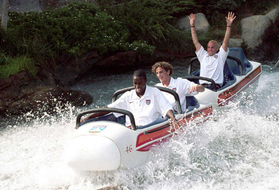 FILE - In this Nov. 2, 1999, file photo provided by Disneyland, members of the U.S. under-17 national soccer team, from left, DaMarcus Beasley, Kyle Beckerman and Landon Donovan take a ride at Disneyland in Anaheim, Calif. In a matchup of teams from the 2014 soccer World Cup, the U.S. plays Ecuador, Friday, Oct. 10, 2014, in an exhibition that marks Donovan's finale with the American national team. (AP Photo/Disneyland) NO SALES
