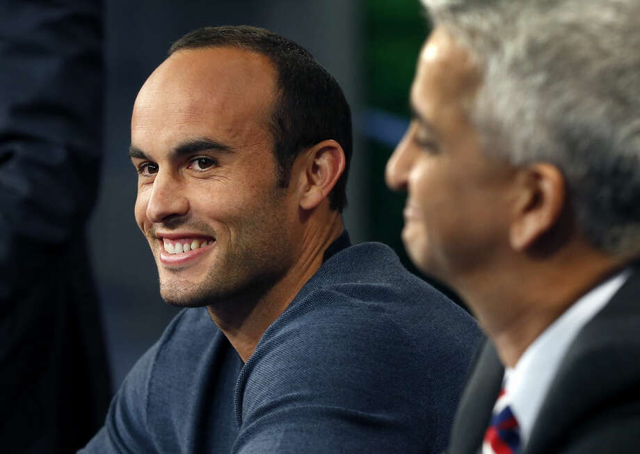 United States' Landon Donovan, left, speaks about his retirement from soccer as Sunil Gulati, president of the United States Soccer Federation, listens during a press conference in Bristol, Conn. Friday, Oct. 10, 2014. Donovan makes his last international appearance Friday night in a soccer exhibition against Ecuador. (AP Photo/Elise Amendola)
