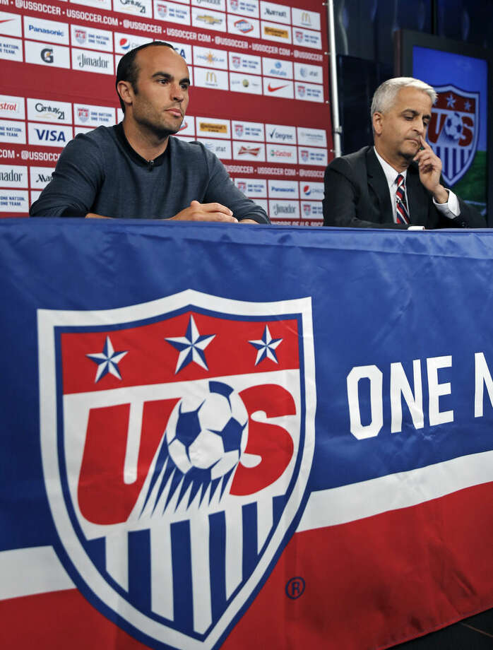 Sunil Gulati, president of the United States Soccer Federation, reacts as United States' Landon Donovan, left, speaks about his retirement from soccer during a press conference in Bristol, Conn. Friday, Oct. 10, 2014. Donovan makes his last international appearance Friday night in a soccer exhibition against Ecuador. (AP Photo/Elise Amendola)