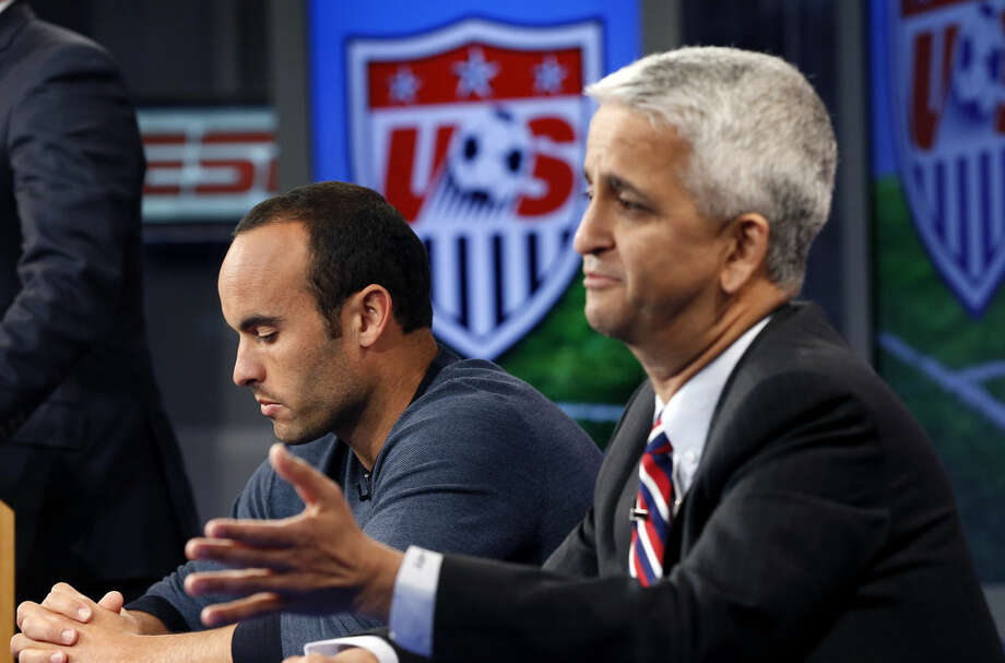 United States' Landon Donovan, left, reacts as Sunil Gulati, president of the United States Soccer Federation, speaks about his retirement from soccer during a press conference in Bristol, Conn. Friday, Oct. 10, 2014. Donovan makes his last international appearance Friday night in a soccer exhibition against Ecuador. (AP Photo/Elise Amendola)