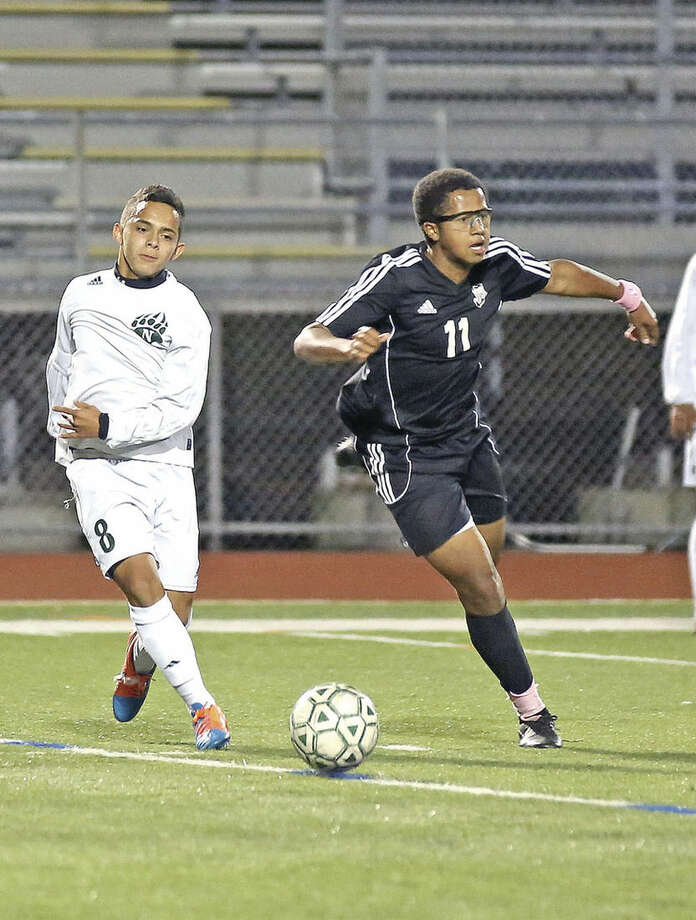 Hour photo/Danielle CallowayNorwalk's Miguel Argueta, left, goes after the ball during a game against Trumbull at Testa Field Thursday evening.