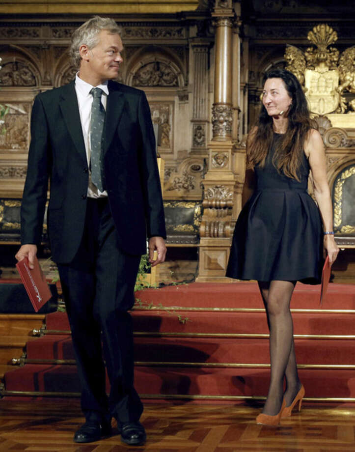 FILE - In this Sept. 5, 2014 file photo winners of the 2014 Nobel Prize for Medicine Norwegian Edvard Moser and his wife May-Britt Moser, from left, attend the Koerber prize awarding ceremony for European science in Hamburg, Germany. (AP Photo/dpa, Chrisitian Charisius, File)