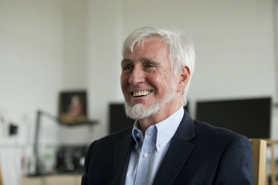 """Joint winner of the Nobel Prize for Physiology or Medicine professor John O'Keefe, a dual U.S. and British citizen, speaks as he is interviewed by The Associated Press in an office he uses at the University College London (UCL), in London, Monday, Oct. 6, 2014. The U.S.-British scientist and a Norwegian husband-and-wife research team won the Nobel Prize in medicine Monday for discovering the brain's navigation system — the inner GPS that helps us find our way in the world — a revelation that one day could help those with Alzheimer's. The research by John O'Keefe, May-Britt Moser and Edvard Moser represents a """"paradigm shift"""" in neuroscience that could help researchers understand the sometimes severe spatial memory loss associated with Alzheimer's disease, the Nobel Assembly said. (AP Photo/Matt Dunham)"""