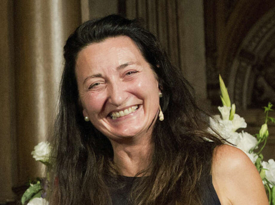 FILE - In this Sept. 5, 2014 file photo the winner of the 2014 Nobel Prize for Medicine Norwegian May-Britt Moser smiles after being awarded the Koerber prize for European science in Hamburg, Germany. (AP Photo/dpa, Chrisitian Charisius, File)