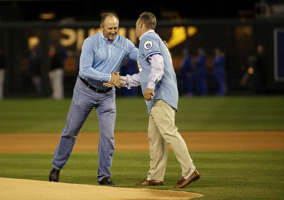 FILE - In this Oct. 14, 2014, file photo, former Kansas City Royals' Bret Saberhagen, left, and George Brett shake hands before Game 3 of the American League baseball championship series against the Baltimore Orioles in Kansas City, Mo. In 1985, Saberhagen pitched a Game 7 shutout to beat the St. Louis Cardinals in the World Series. (AP Photo/Matt Slocum , File)