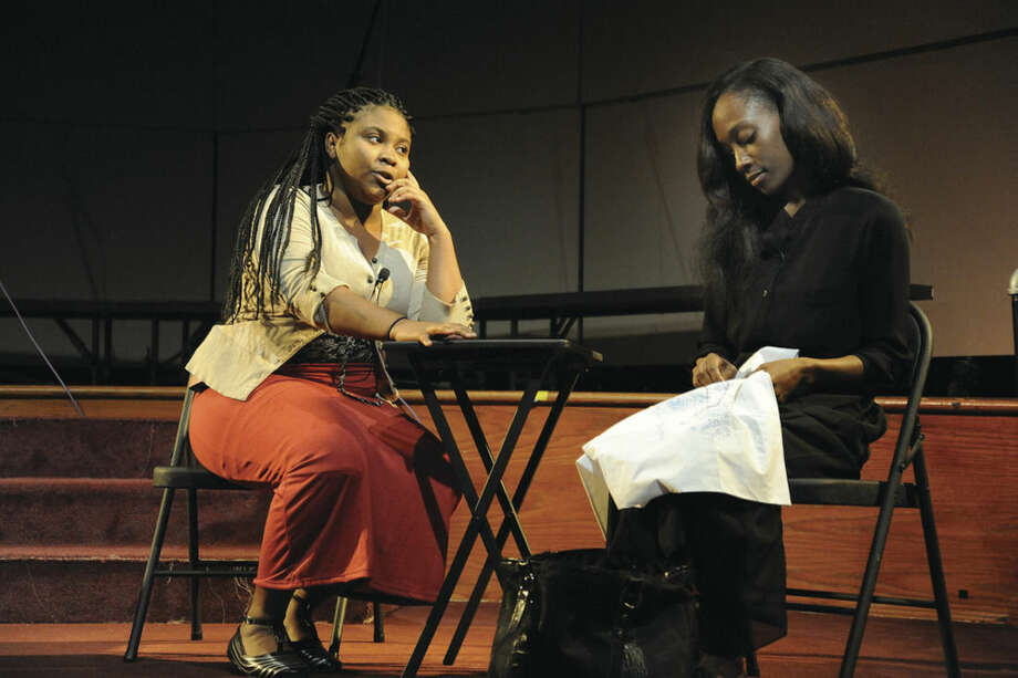 "Hour photo/Matthew VinciStacie Dmehonse and Kerry-Ann Smithare, Norwalk Community College theater actors, do a short performance Tuesday at the school's Pepsi Theater. The college held ""Intimate Apparel"" Day to celebrate the play of the same name currently appearing at the Westport Country Playhouse."