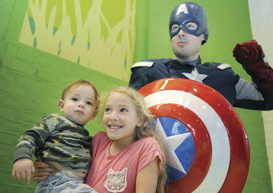 Hour photo/Matthew VinciKayla Damiano, 7, and Max Newman, 1, meet Captain America Sunday at The Maritime Aquarium, where Spiderman and Captain America were there to meet and take pictures with children and families.