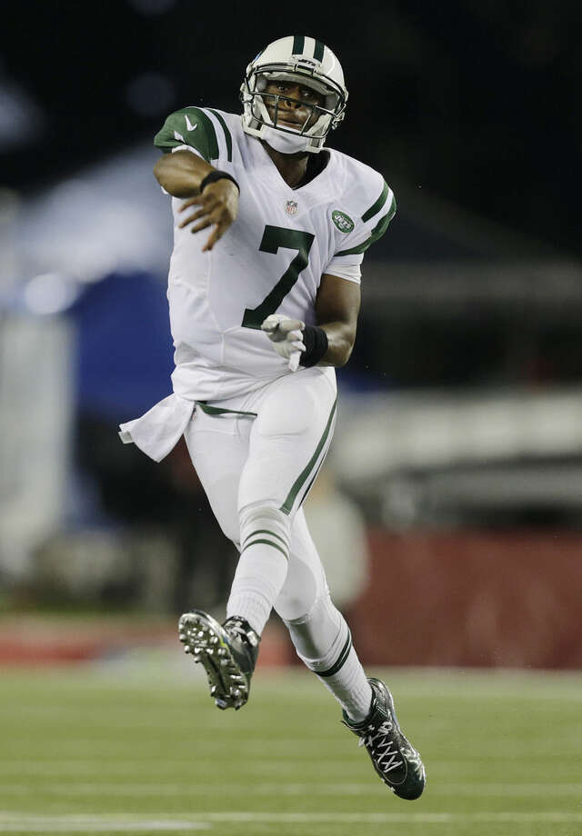 New York Jets quarterback Geno Smith follows through on a pass against the New England Patriots in the first half of an NFL football game Thursday, Oct. 16, 2014, in Foxborough, Mass. (AP Photo/Charles Krupa)