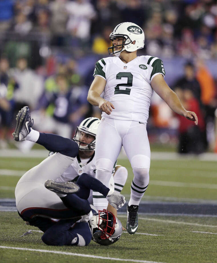 New York Jets kicker Nick Folk (2) watches as his field goal attempt is blocked on the final play of an NFL football game against the New England Patriots on Thursday, Oct. 16, 2014, in Foxborough, Mass. The Patriots won 27-25. (AP Photo/Charles Krupa)