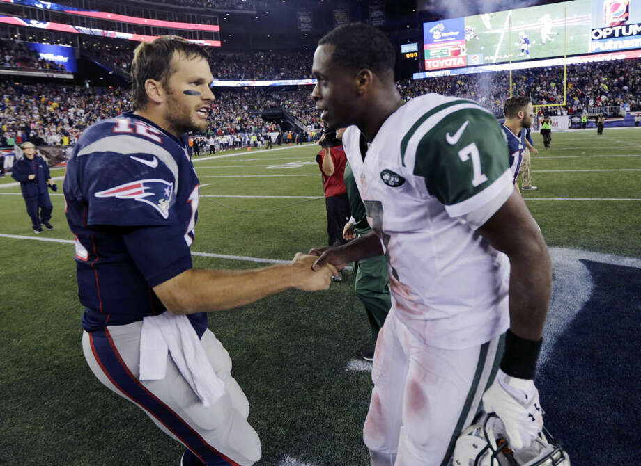 New England Patriots quarterback Tom Brady, left, shakes hands with New York Jets quarterback Geno Smith after an NFL football game Thursday, Oct. 16, 2014, in Foxborough, Mass. The Patriots won 27-25. (AP Photo/Charles Krupa)