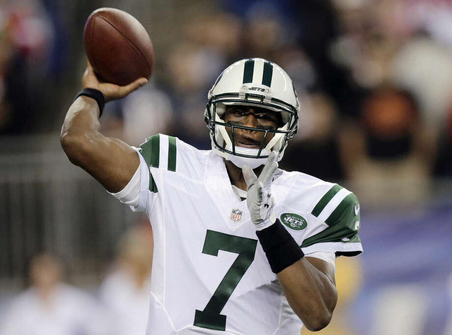 New York Jets quarterback Geno Smith throws a pass against the New England Patriots during the first half of an NFL football game Thursday, Oct. 16, 2014, in Foxborough, Mass. (AP Photo/Charles Krupa)