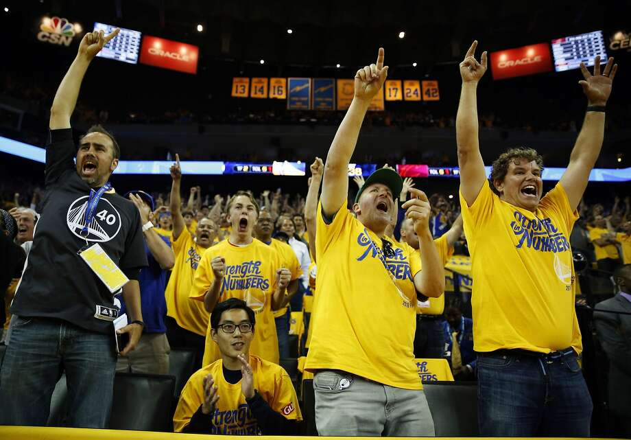 Jeremy Gordon (left), Victor Chen, Sol Lipman and Jeff Bonforte cheer with other fans during Game 5 of the NBA Finals between the Warriors and the Cleveland Cavaliers at Oracle Arena in Oakland, California, on Monday, June 13, 2016. Photo: Connor Radnovich, The Chronicle