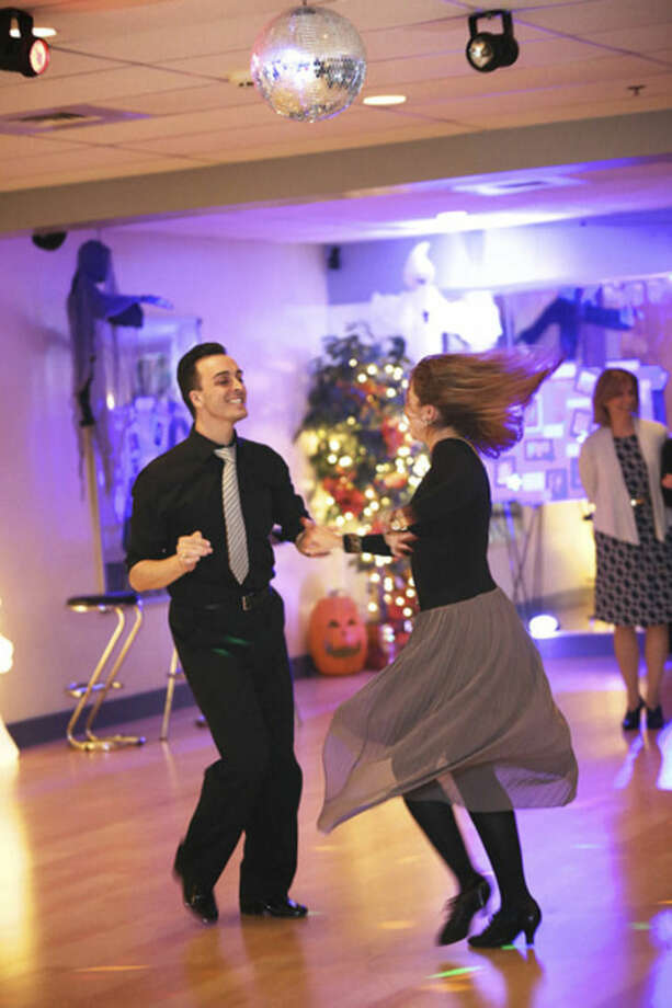 Manuel Trillo and Anastasia Zhitova from Fred Astaire Dance Studio in Norwalk show dancers a routine in preparation for the 2nd annual Dancing With The Stars event to benefit ElderHouse Thursday evening.Hour Photo / Danielle Calloway