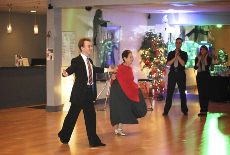 Matthias Kruschel from Fred Astaire Dance Studio in Norwalk and Joan Blumenfeld show dancers a routine in preparation for the 2nd annual Dancing With The Stars event to benefit ElderHouse Thursday evening.Hour Photo / Danielle Calloway