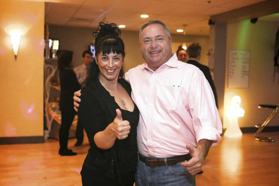 Gina Goethche from Fred Astaire Dance Studio in Norwalk shows Tony Aitoro a routine in preparation for the 2nd annual Dancing With The Stars event to benefit ElderHouse Thursday evening.Hour Photo / Danielle Calloway