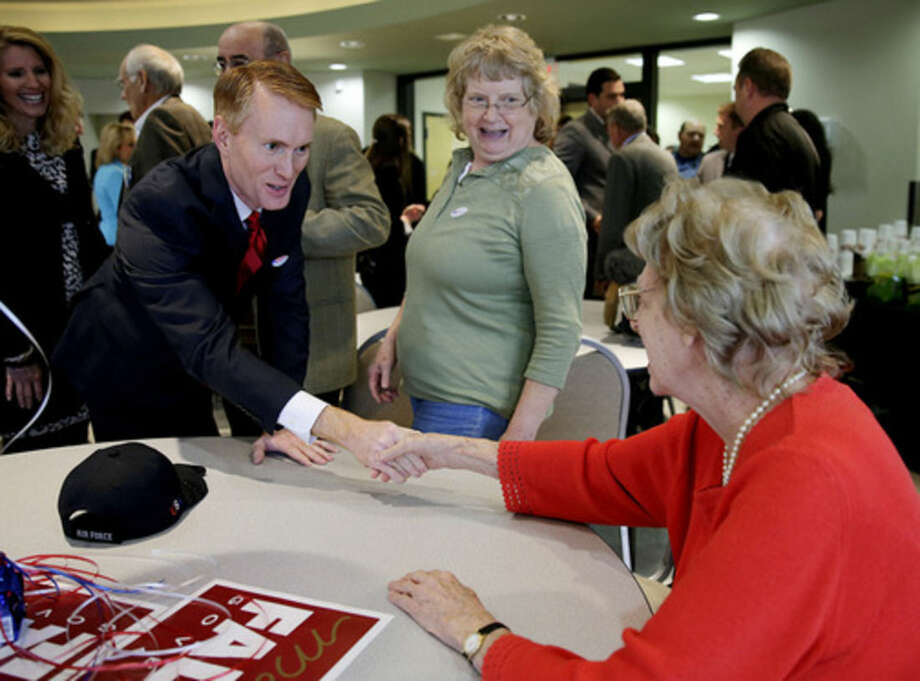James Lankford, left,, greets Sophie E. Boutell, 96, as her daughter Karen Boutell looks on during a Republican rally at LaFortune Park on Election Day, Tuesday, Nov. 4, 2014. (AP Photo/Tulsa World, Mike Simons) ONLINE OUT; KOTV OUT; KJRH OUT; KTUL OUT; KOKI OUT; KQCW OUT; KDOR OUT; TULSA OUT; TULSA ONLINE OUT