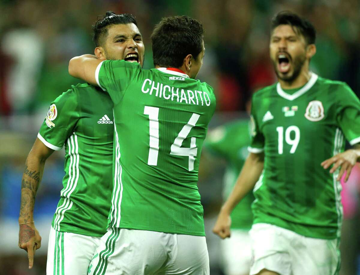 Mexico forward Jesus Manuel Corona, left, celebrates his game-tying goal against Venezuela with forward Javier Hernandez (14) and forward Oribe Peralta (19) during the second half of a Copa America Centenario group C soccer match on Monday, June 13, 2016, in Houston. The match ened in a 1-1 draw.