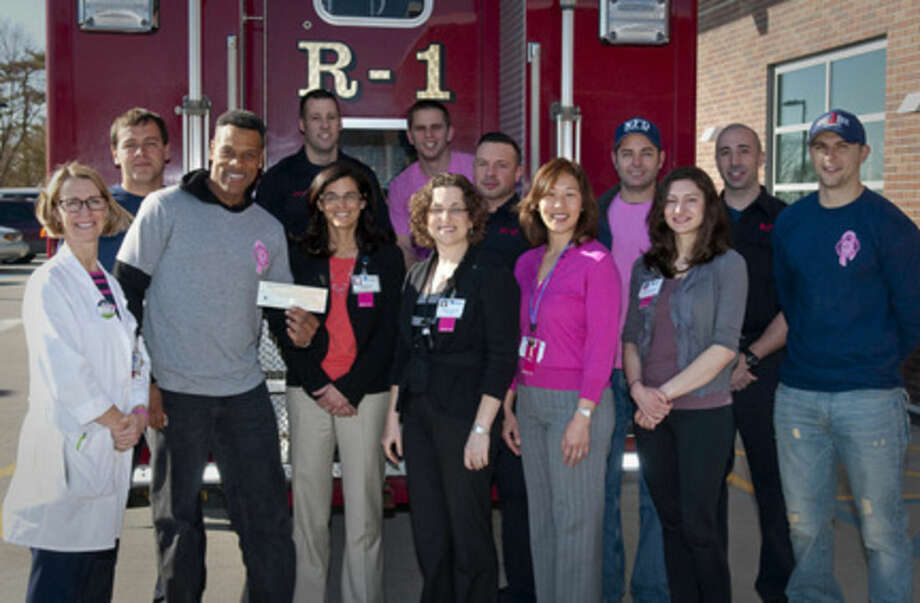 Contributed photoMembers of the Norwalk Fire Department are pictured with the staff of the Smilow Family Breast Health Center at Norwalk Hospital after presenting last year's check to the Center. Over the last two years, the Department raised $13,000 for the breast cancer patients at Norwalk Hospital. Front row, from left are are: Mary Heery, APRN, Ralph Geter (holding check), Dr. Jeanne Capasse, Dr. Heather Frimmer, Linda Versea, APRN, and Laura Gianninoto, APRN. Back row: Mike Vinci, Dave Janofsky, Dave Dustin, Jesse Granton, Jimmy Lyons, Matt Zaremski, and Anthony Papacod.