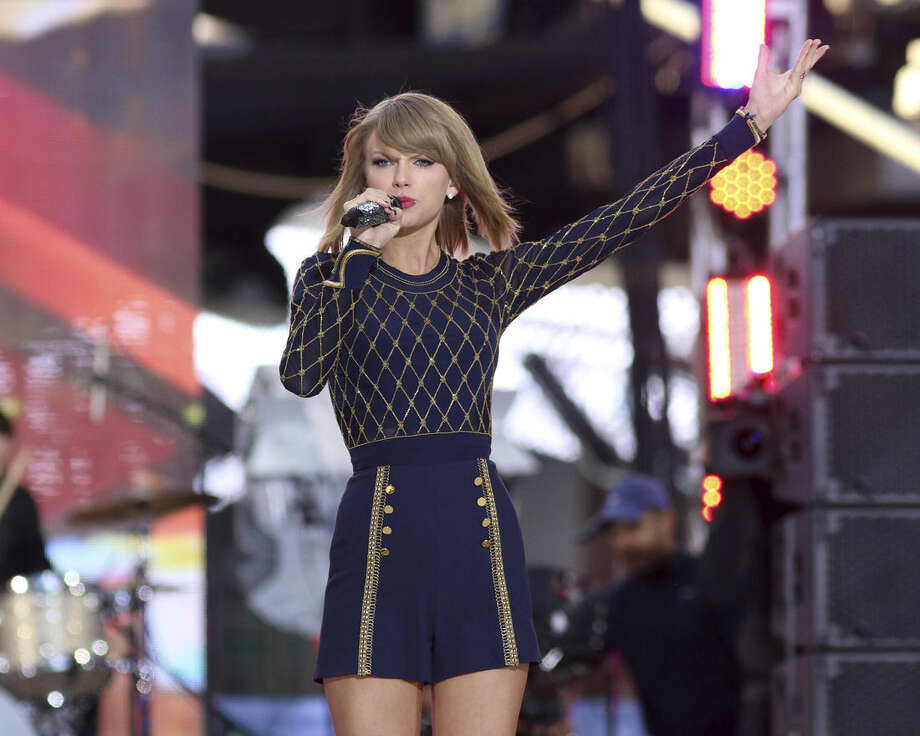 "FILE - In this Oct. 30, 2014 file photo, Taylor Swift performs on ABC's ""Good Morning America"" in Times Square in New York. The music streaming service Spotify is no longer offering Taylor Swift songs at her request, setting up a battle between the industry's most popular artist and the leading purveyor of a new music distribution system. Spotify, which pulled Swift's songs on Monday, Nov. 3, 2014, said that ""we hope she'll change her mind and join us in building a new music economy that works for everyone."" (Photo by Greg Allen/Invision/AP, File)"