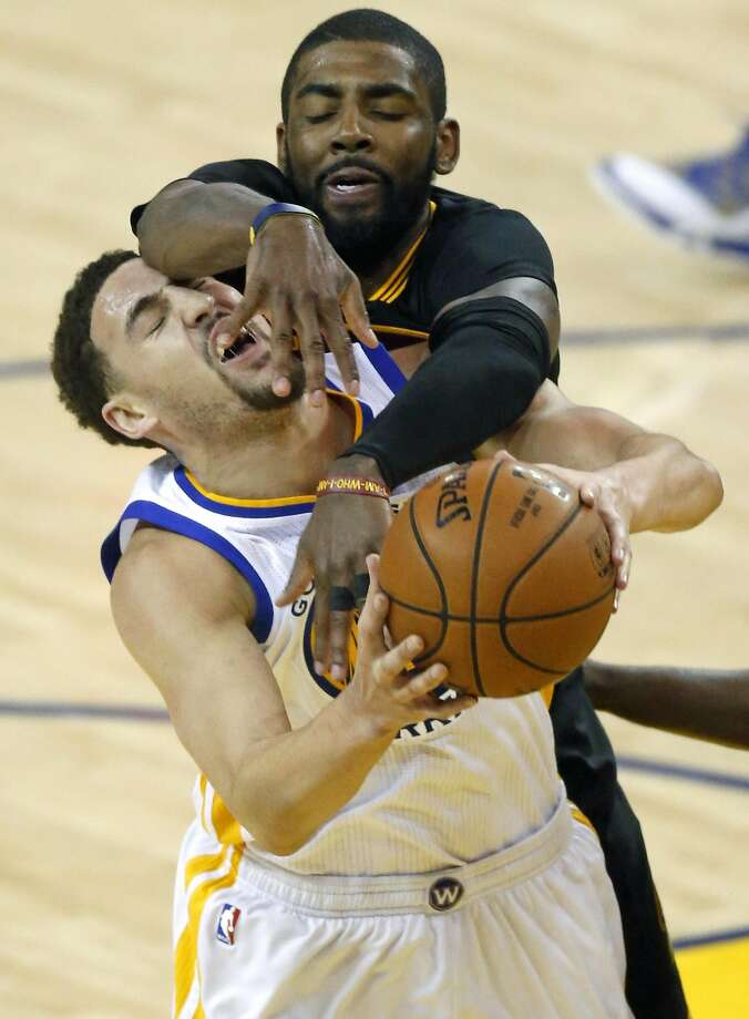 Golden State Warriors' Klay Thompson is fouled by Cleveland Cavaliers' Kyrie Irving in 2nd quarter in Game 5 of  the NBA Finals at Oracle Arena in Oakland, Calif., on Monday, June 13, 2016. Photo: Scott Strazzante, The Chronicle