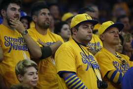Fans watch with unease during the second quarter of Game 5 of the NBA finals between the Warriors and the Cavaliers at the Oracle Arena June 13, 2016 in Oakland, Calif.
