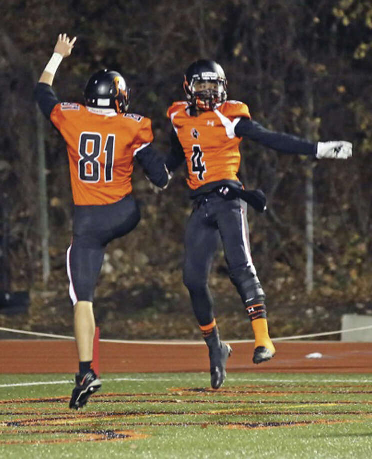 Photo by Danielle CallowayStamford's Andrew Antonie (4) and Billy Devito (81) celebrate a touchdown during the Black Knights' 42-21 win over Westhill at Boyle Stadium on Tuesday.