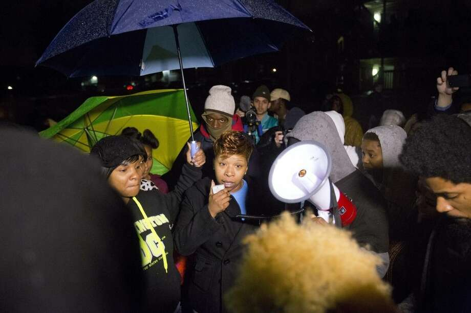 Lesley McSpadden, center, the mother of Michael Brown speaks to protestors during a demonstration at the memorial near where the black teen was shot and killed by a white policeman more than three months ago, Saturday, Nov. 22, 2014, in Ferguson, Mo. Ferguson and the St. Louis region are on edge in anticipation of the announcement by a grand jury whether to criminally charge officer Darren Wilson in the killing of 18-year-old Michael Brown. (AP Photo/David Goldman)