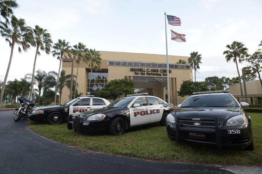 Police cruisers sit outside the Maxwell C. King Center for the Performing Arts before a Bill Cosby performance at Easter Florida State College in Melbourne, Fla., Friday, Nov. 21, 2014.(AP Photo/Phelan M. Ebenhack)