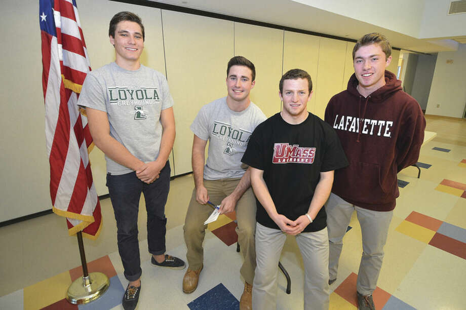 Hour Photo/Alex von KleydorffStaples High School student-athletes, from left, North Woods, Lucas jackson, Issac Paparo and Peter Richards have signed Letters of Intent to play sports in college.