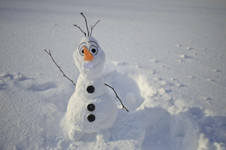 ' was recreated by Students from the Grand Valley State University campus, built snowman that looks like the character Olaf from the movie 'Frozen' in Allendale, Mich., Tuesday, Nov. 18, 2014. Lake-effect storms in Michigan produced gale-force winds and as much as 18 inches of snow, and canceled several flights at the Grand Rapids airport. (AP Photo/The Grand Rapids Press, Joel Bissell) ALL LOCAL TELEVISION OUT; LOCAL TELEVISION INTERNET OUT