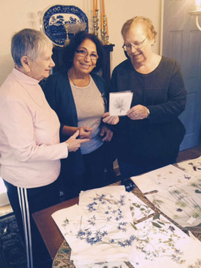 Contributed photoThree Norwalk Garden Club members enjoy the artistic artwork they and many others created recently for the Annual Holiday Craft Fair to be held on Dec. 6 at Cranbury Chapel in Norwalk. Left to right, Marion Ainsworth, Silvia Price, and Nancy Lefort.