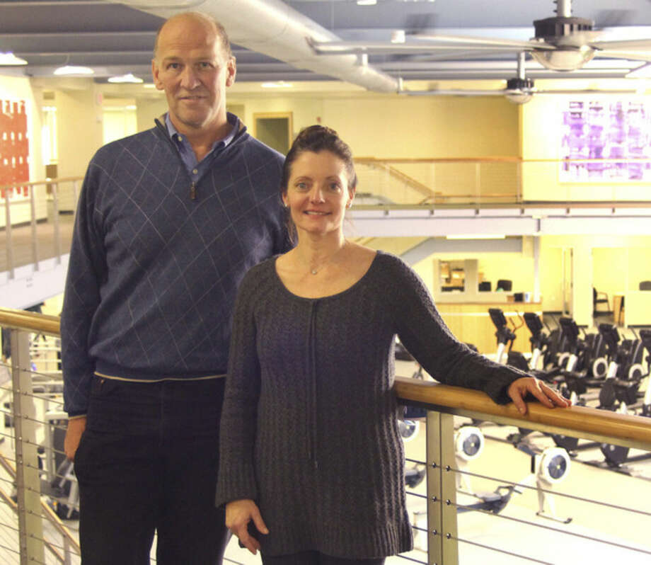 Hour photo/Chris BosakDavid Tewksbury, executive vice president of Chelsea Piers, and Greta Wagner, executive director of Chelsea Piers CT stand in the facility's new fitness center during an open house on Wednesday evening.